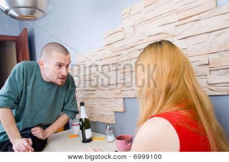conflict between man and woman at the table
