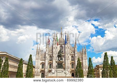 Milan Duomo Cathedral against a cloudy sky in summer.