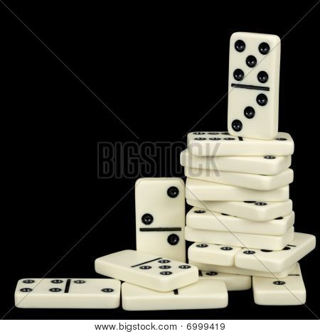 Pile Of Dominoes Isolated On Black Background