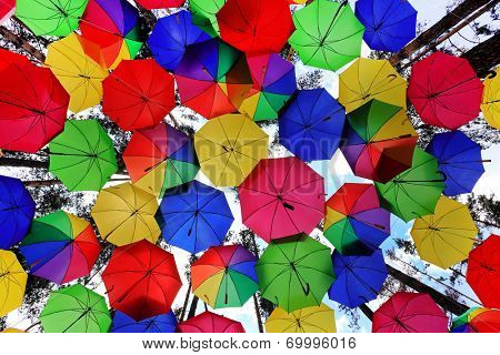 Lots of colorful umbrellas in the sky