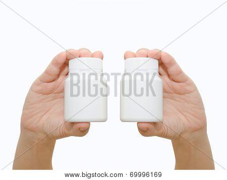 Hand Holding A Pill Bottle