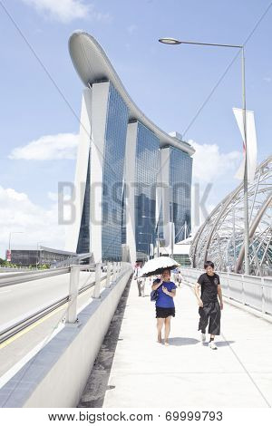 SINGAPORE - JULY 24: Unidentified people walking on street on July 24, 2014 in Singapore.