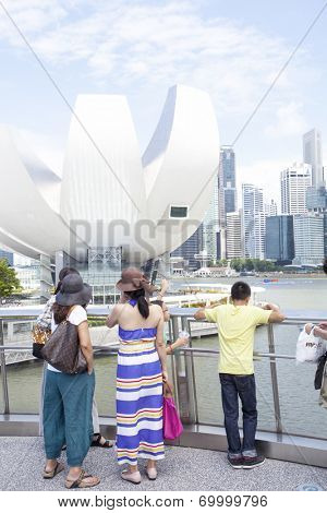 SINGAPORE - JULY 24: Unidentified people walking on Helix Bridge on July 24, 2014 in Singapore. The Helix Bridge links the Marina Centre & Bayfront areas.