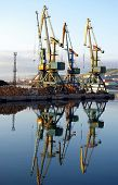 picture of sakhalin  - Portal cranes with reflection  in sea port - JPG