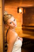 image of sauna  - Young woman relaxing in a sauna - JPG