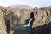 stock photo of arctic landscape  - Waterfall and arctic landscape in a rocky environment on Disko Island in Greenland - JPG