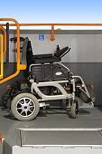 stock photo of motor-bus  - Electric wheelchair at allocated space in public bus - JPG
