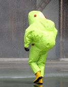 stock photo of jumpsuits  - man with the yellow jumpsuit for the biohazard during a chemical warfare simulation 3