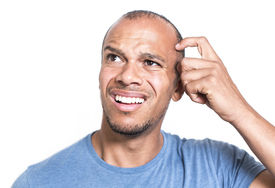 image of confusing  - A mixed race man looking confused about something - JPG