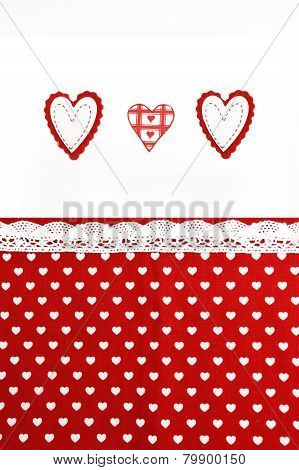 Valentines Day background with hand made hearts and fabric background