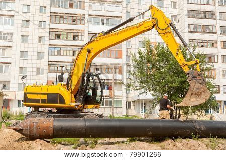 Using of excavator as crane for raising of pile