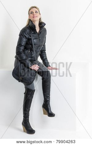 woman wearing platform black boots with a handbag