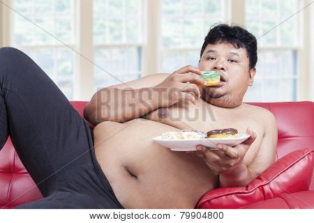 Lazy Fat Person Eating Donuts