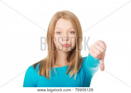 Upset young teenager showing thumbs down