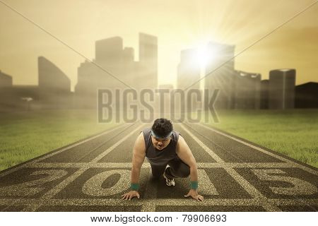 Obesity Person Kneeling On The Track