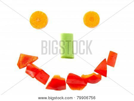 Smiling face shape formed with chopped red pepper, carrot and beans isolated on white background.