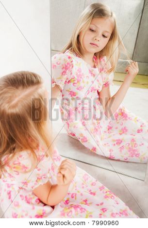 Little Girl Looking At Mirror, Studio Portrait