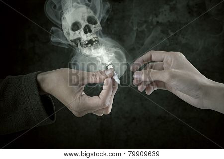 Two  Smokers Sharing Cigarette