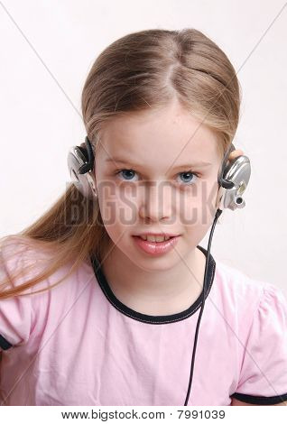 Girl Child, Studio Closeup Portrait With Headphones