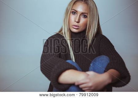 Pretty Young Woman Sitting On Floor