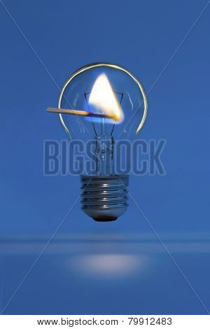 Lighted Match And A Bulb