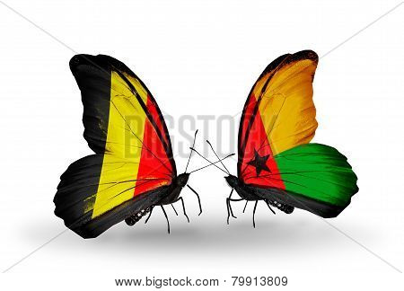 Two Butterflies With Flags On Wings As Symbol Of Relations Belgium And Guinea Bissau