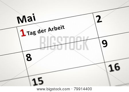 An image of a calendar detail shows May the first Labor Day in german language