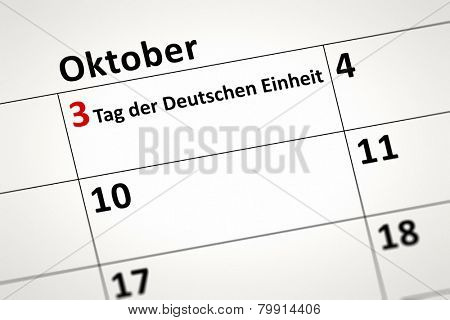 An image of a calendar detail shows october the 3rd Day of German Unity in german language