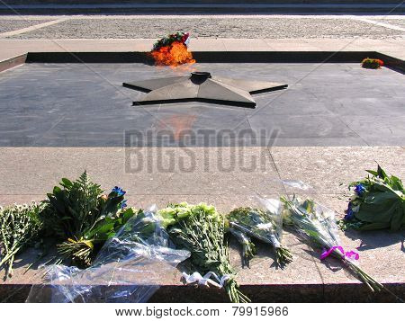 Eternal Fire With Laid Flowers On Square