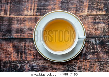 Cup Of Herbal Tea On Wooden Table