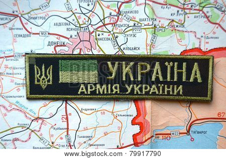 Illustrative editorial.Unformal chevron of Ukrainian Army.With map of Donetsk and Illovaisk. Former Ukraine.At present time Novorossia. At January 10,2015 in Kiev, Ukraine