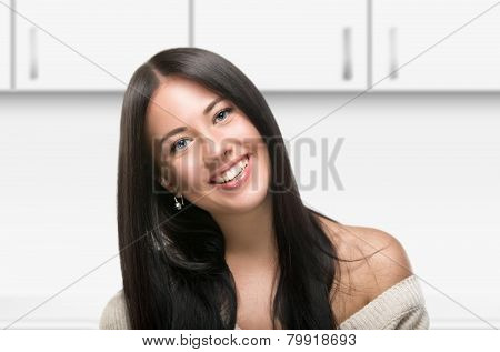 portrait of beautiful woman at home in kitchen