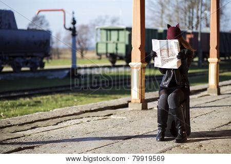 Woman Examing Map At Station Platform