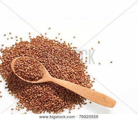 Buckwheat and wooden spoon