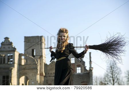 Witch With Pale Skin With Broom