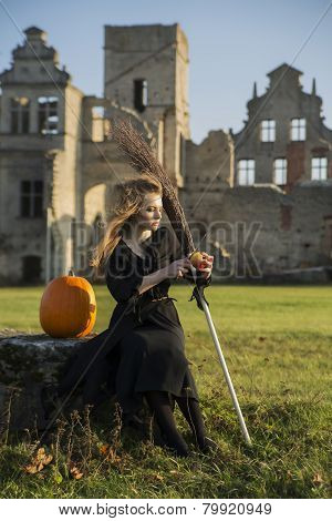 Witch With Pale Skin Peeling Ripe Apple