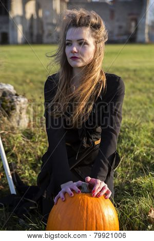 Witch With Pale Skin Hands On Pumpkin
