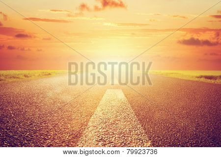 Long empty asphalt road towards sunset sun. Wide perspective, conceptual way