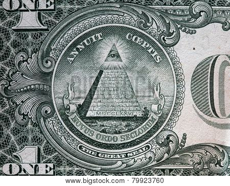 Annuit coeptis motto and the Eye of Providence on the reverse side of one American dollar bill. USD