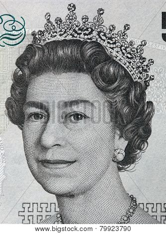 Queen Elizabeth II portrait on 5 pound sterling banknote. British currency