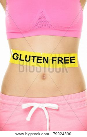 Gluten free health and Celiac disease and digestion concept with GLUTEN FREE text written on stomach abdomen sign on woman belly. Conceptual food allergies image.