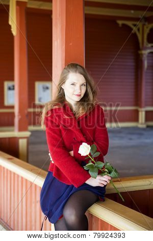 Woman With Bright Skin And White Rose