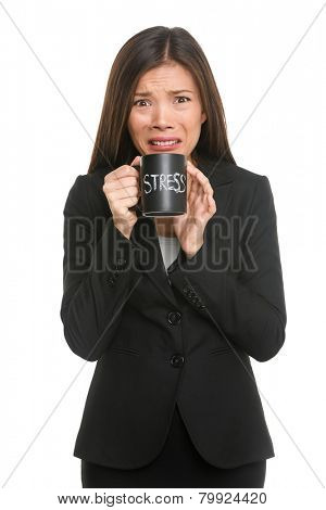 Stress. Business woman stressed being too busy. Businesswoman in suit holding head drinking coffee creating more stress. Mixed race Asian Caucasian female isolated on white background.