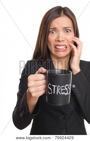 Stress concept. Business woman stressed being too busy. Businesswoman in suit holding head drinking coffee creating more stress. Mixed race Asian Caucasian female isolated on white background.