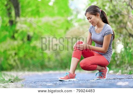 Side stitch - woman runner side cramps after running. Jogging woman with stomach side pain after jogging work out. Female athlete.