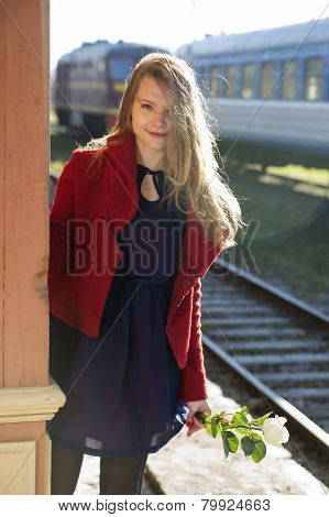 Woman On Station And Sunlight Over Hairs