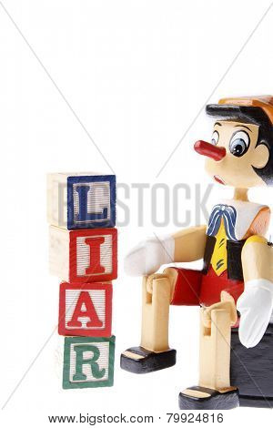 Wooden pinocchio and word liar