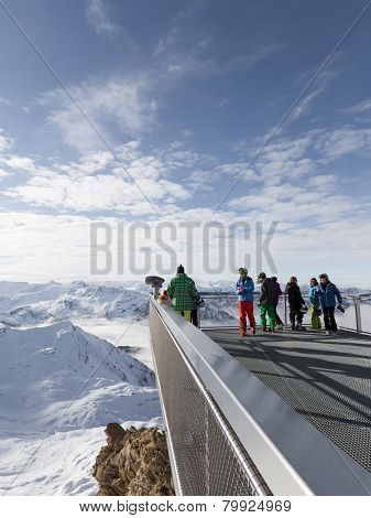 People Look At The Snowy Alps