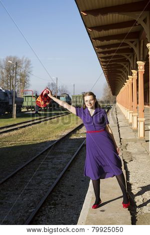 Woman In Lilac Dress Vote At Station