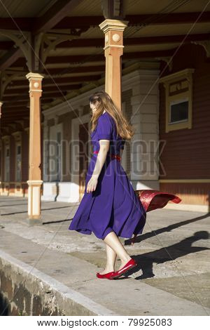 Woman In Lilac Dress At Station Platform
